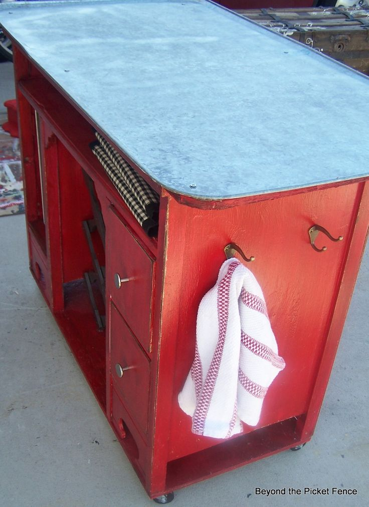 repurposed desk, kitchen island, red paint, oil drip pan, Beyond The Picket Fence, http://bec4-beyondthepicketfence.blogspot.com/2013/08/shutter-island.html