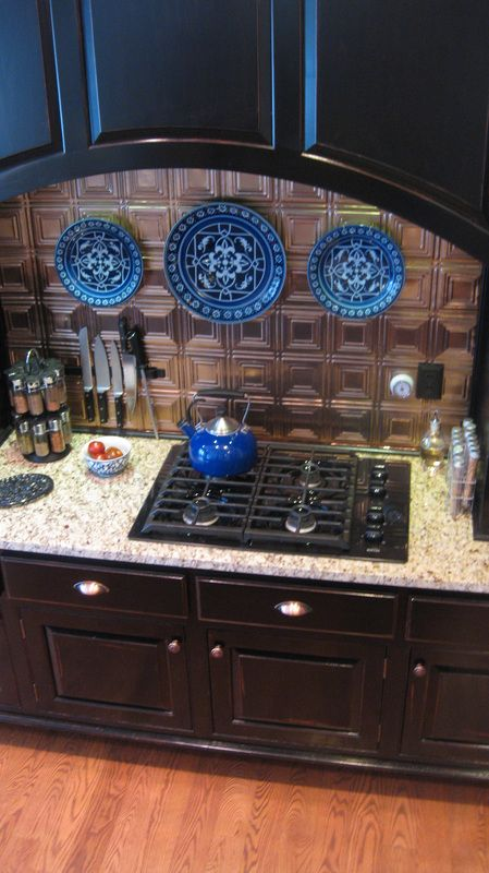 bronze tin backsplash black cupboards  Kitchen ideas  Pinterest