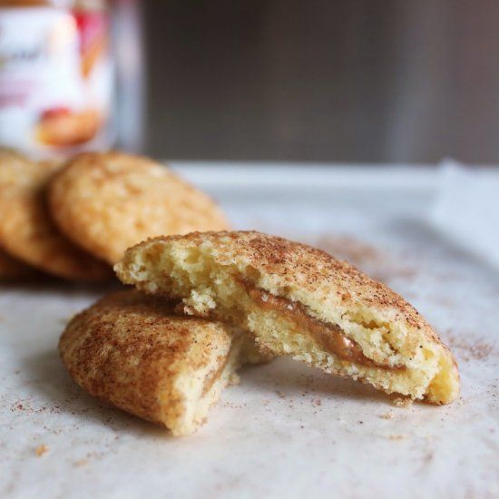 Snickerdoodle cookies stuffed with amazing Biscoff / cookie spread.