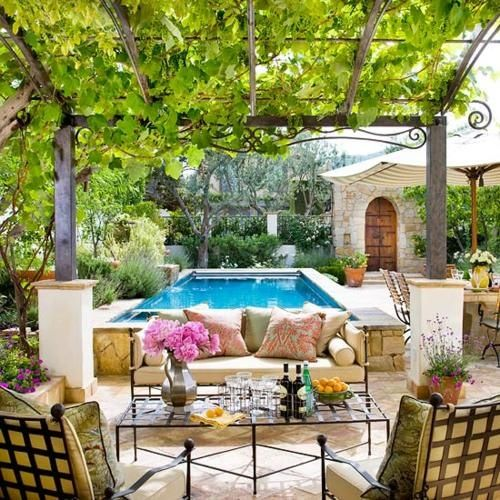A canopy of leaves provides a welcome (and oh-so-pretty) bit of shade in this backyard