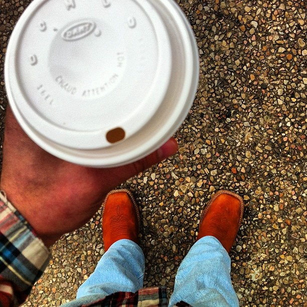 Coffee cup and cowboy boots from Instagram user iquelugo