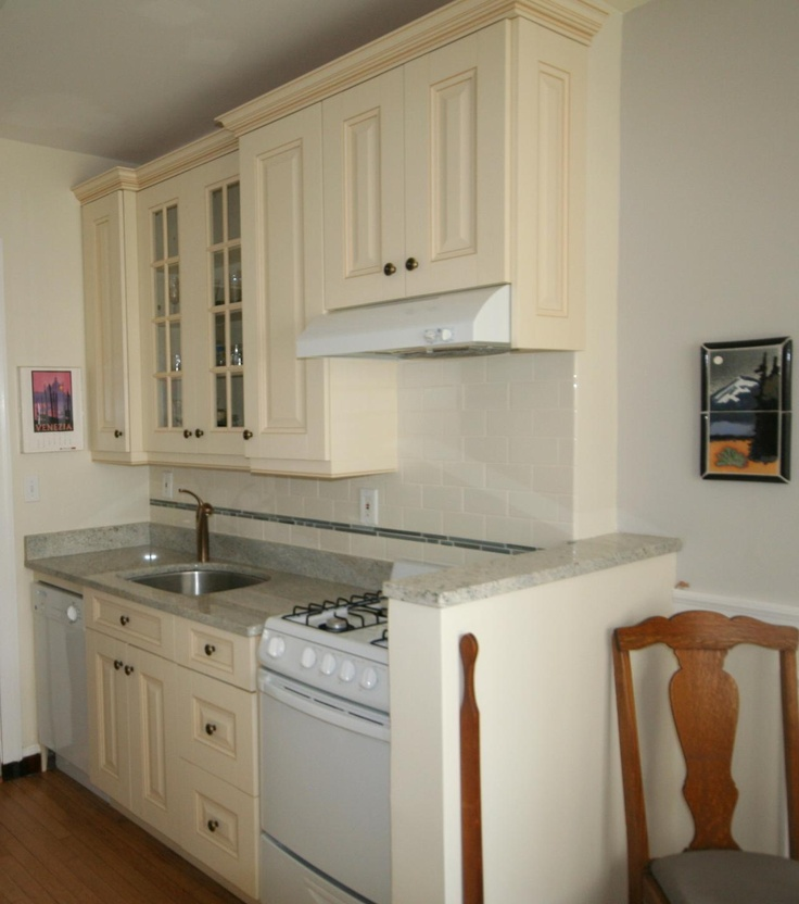 White galley kitchen white kitchens ivory kitchens for Galley kitchen designs with white cabinets