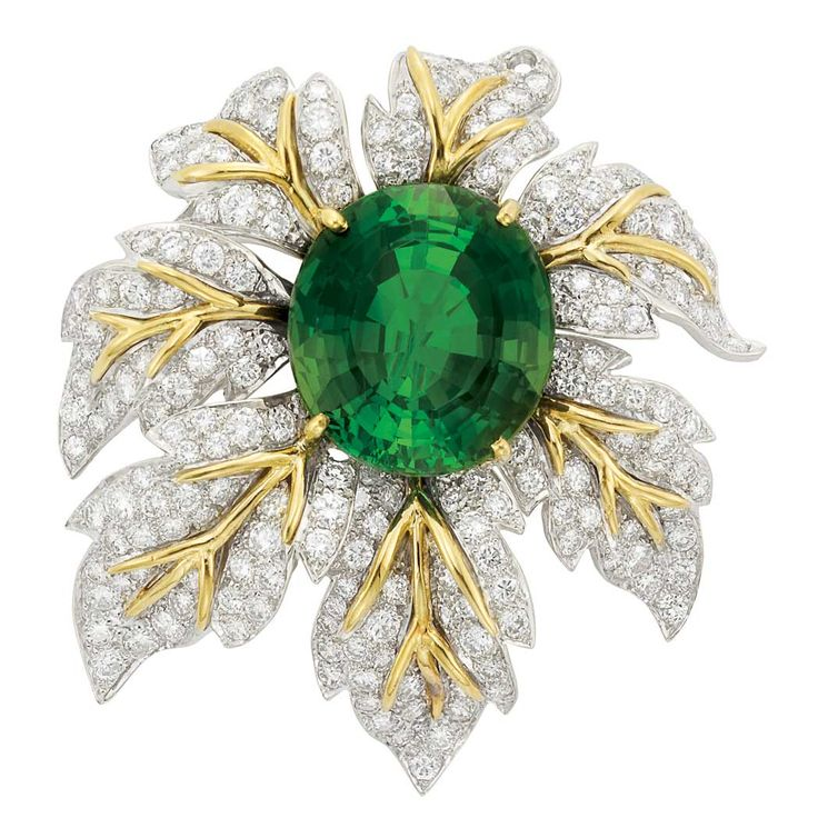Two-Color Gold, Tourmaline and Diamond Clip-Brooch  18 kt., centering one oval tourmaline approximately 27.50 cts., surrounded by white gold leaves centering polished yellow gold veins, encrusted with 196 round diamonds approximately 7.85 cts., with maker's mark, one diamond missing, approximately 20.8 dwts.