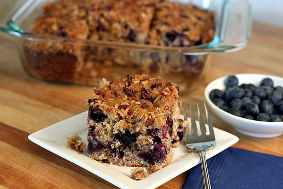 This blueberry oat breakfast cake with a warm cup of coffee makes me ...