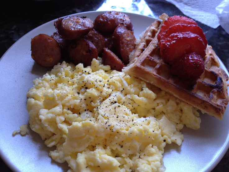 Belgian waffle with scrambled eggs and sausage