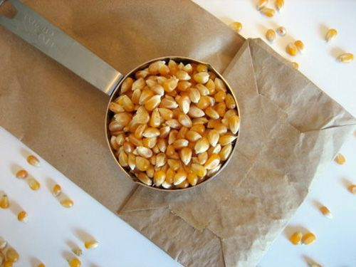 Microwave your own popcorn in brown paper sacks.