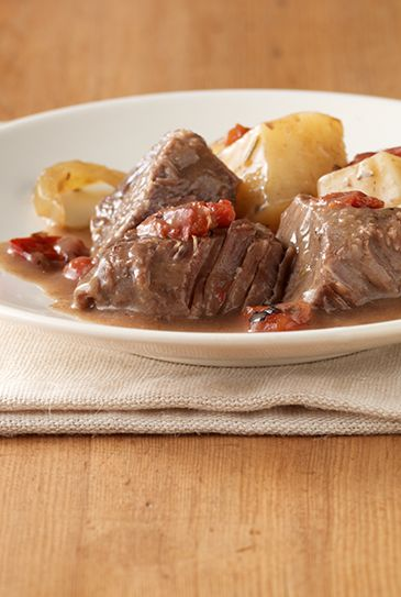 pot roast --- flavored tomatoes cook down with cream of mushroom soup ...