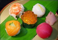 Temarizushi (ball sushi) is a ball-shaped sushi made by pressing rice ...