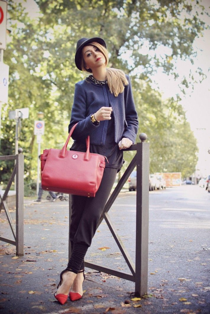 red pumps, red bag, pants, and blue blazer