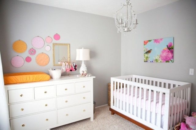 Use fabric in embroidery hoops or wrapped over canvas for cheap nursery wall art! #DIY #nursery