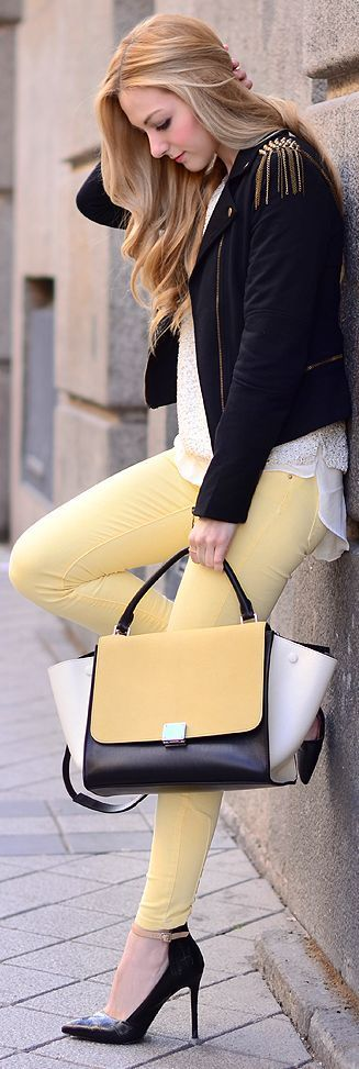 Cream pants shirt with same colour handbag and black jacket
