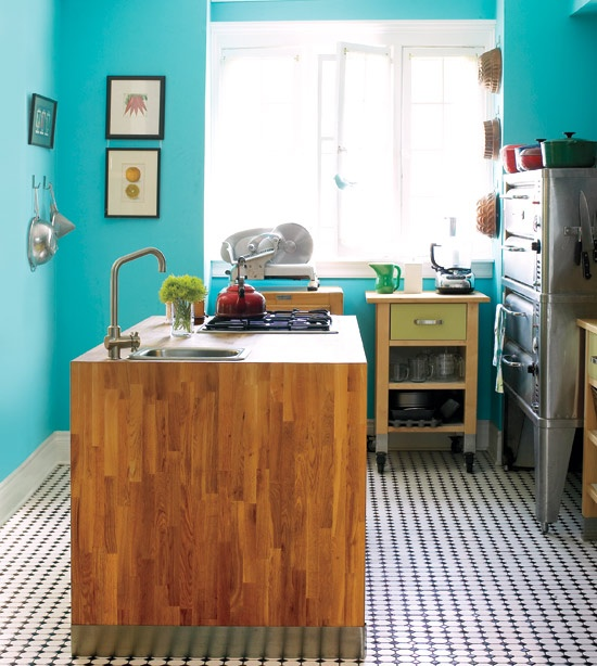 vibrant turquoise walls + wood waterfall island + b+w pattern floor in eclectic heritage kitchen of anna olson