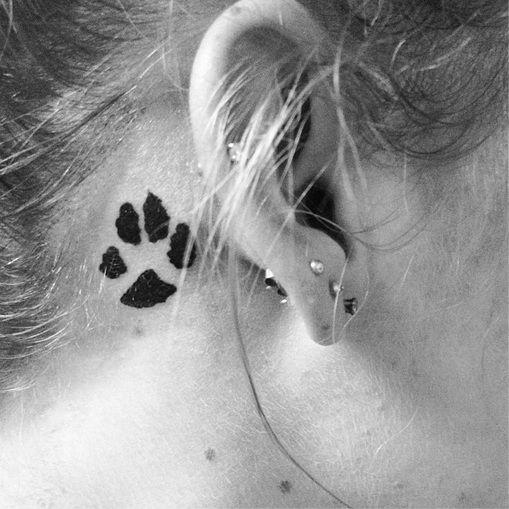 Dog paw print tattoo design idea behind the ear