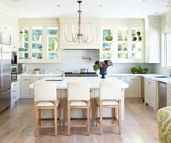 glass BACKED cabinets!  add storage + more light in the kitchen with this creative idea: glass backed cabinets!