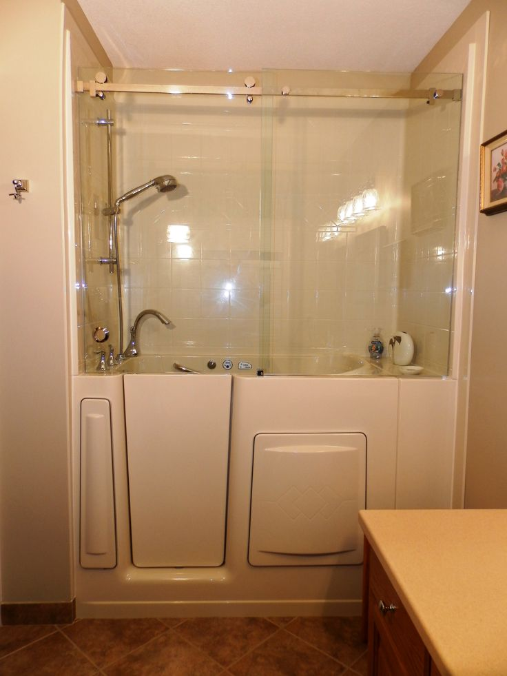 Escape plus walk in bathtub with 3 wall composite surround for Top hung sliding glass doors
