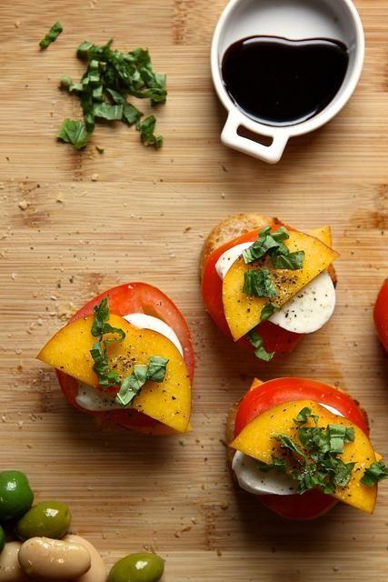 Peach, Tomato, and Mozzarella Crostini | via Joy the Baker