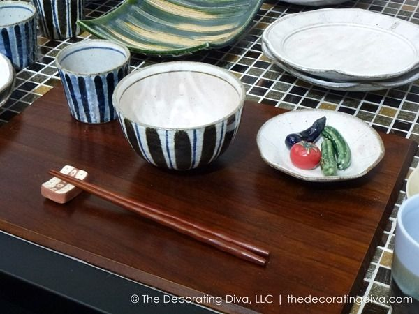 Striped glazeware dining collection set atop warm, wood serving tray. | The Decorating Diva, LLC