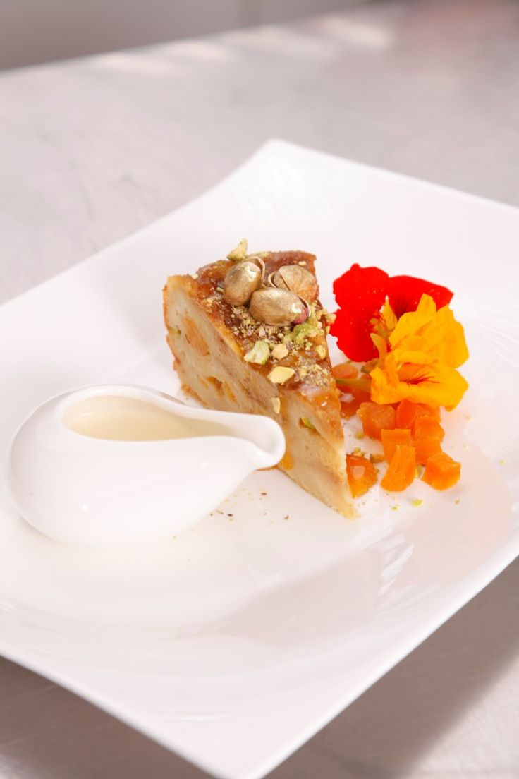 ... and pistachio bread and butter pudding with warm honey and cream