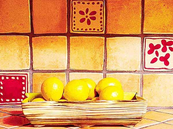 yellow red tile backsplash