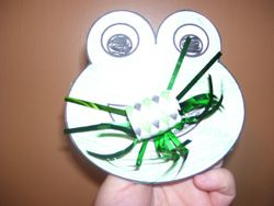 "add velcro to the end of the blower and make flies out of felt to ""catch"" with the frog"