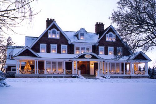 So pretty....love the front porch and love the symmetry of the house