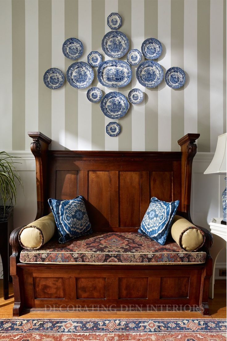 I love this arrangement! http://christineringenbach.files.wordpress.com/2012/08/wooden-bench-with-pilows-and-blue-and-white-china-plates-on-wall.jpg