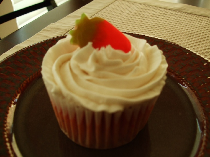 ... vanilla malted buttercream icing, and finished with a candy strawberry