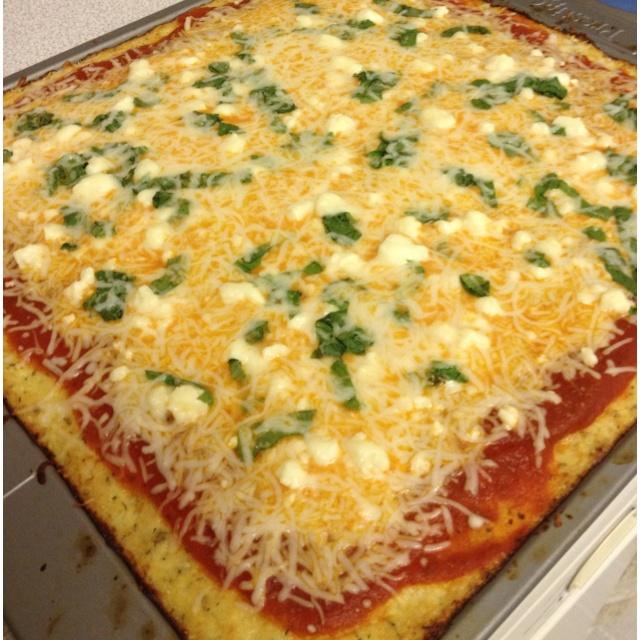 Home made tomato garlic, mozzarella, feta and fresh basil pizza on a ...