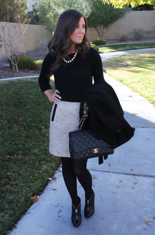 black turtleneck, black tights, help let the skirt be the focus.  Black shoes help elongate the legs.