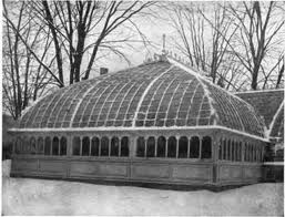 Snow-covered square greenhouse with curved roof