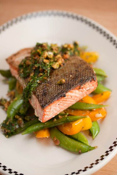salmon with snap peas yellow peppers and dill pistachio pistou