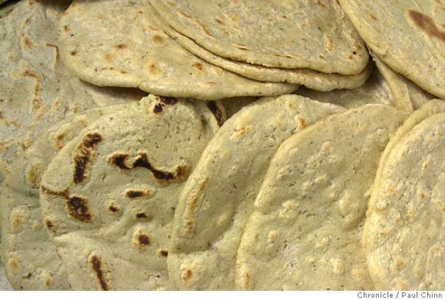 For enfrijoladas, corn tortillas are dipped into pureed black beans ...