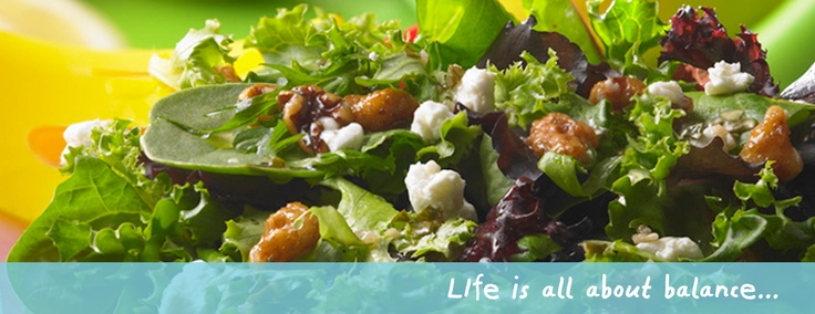 Our warm walnut-crusted goat cheese salad. With baked goat cheese atop ...
