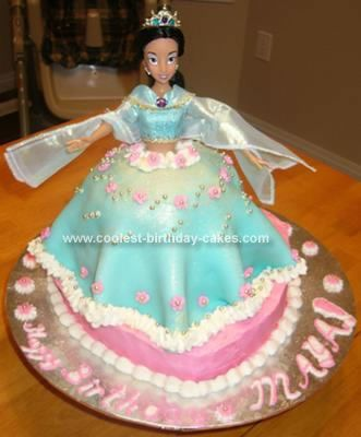 Homemade Princess Jasmine Cake: My daughter wanted a Princess Jasmine cake for her 5th Birthday. My mom bought the Jasmine Barbie from the Disney store. It was quite a beautiful doll.