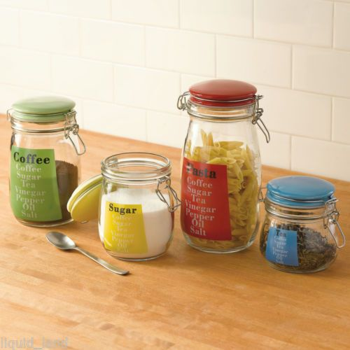 set of 4 glass kitchen canisters w multi colored lids