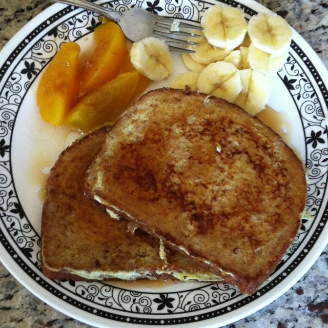 French toast with peaches and brown sugar, and banana slices