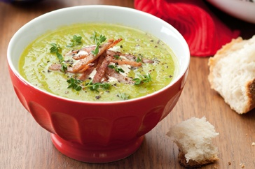 Classic pea and ham soup, fragrant with thyme and topped with sour ...
