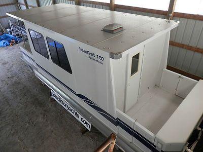 Trailerable houseboats 2005 safari craft trailerable for Pontoon boat interior designs