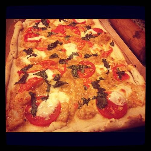 ... pizza with spicy cream sauce, heirloom tomatoes and fresh basil