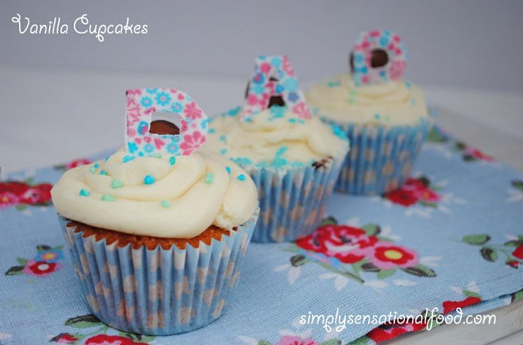 food: Vanilla Cupcakes and a birthday celebration. I like the letters ...