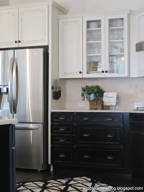 of cabinet around fridge that is  white  with dark cabinets below