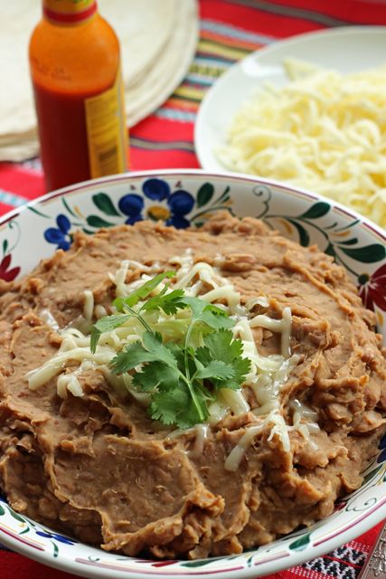 "Healthier Refried Beans - Cook up a pot of healthier ""refried"" beans to serve as a side dish, to fill burritos, or to top nachos."