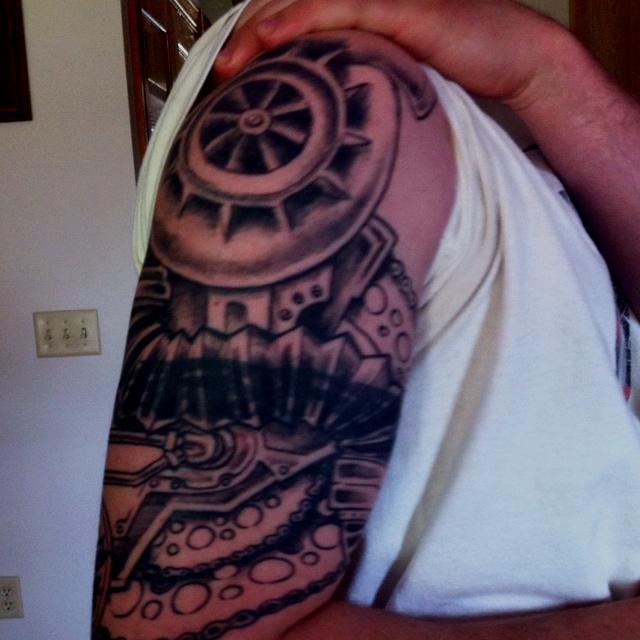 Upper sleeve tattoo