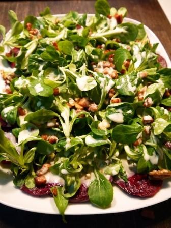 Winter salads with spinach leaves, beet root, walnuts and pome granate