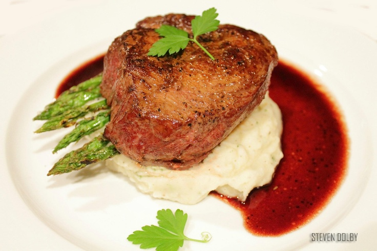 Filet mignon with red wine reduction sauce by Steven Dolby