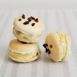 White chocolate macarons with crunchy cocoa nibs
