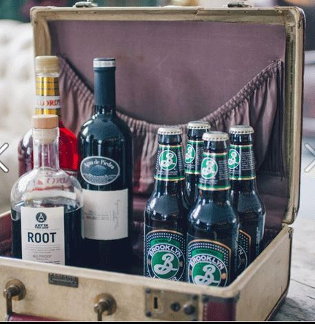 display the booze you are serving in a vintage suitcase on the bar - http://www.weddingchicks.com/