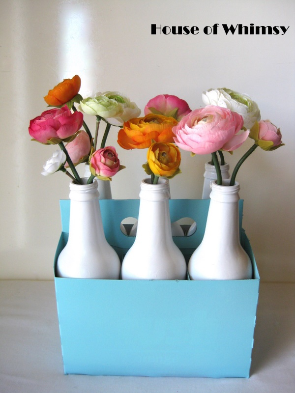 Inexpensive DIY Centerpieces using soda bottles sprayed Rust-oleum Painters Touch