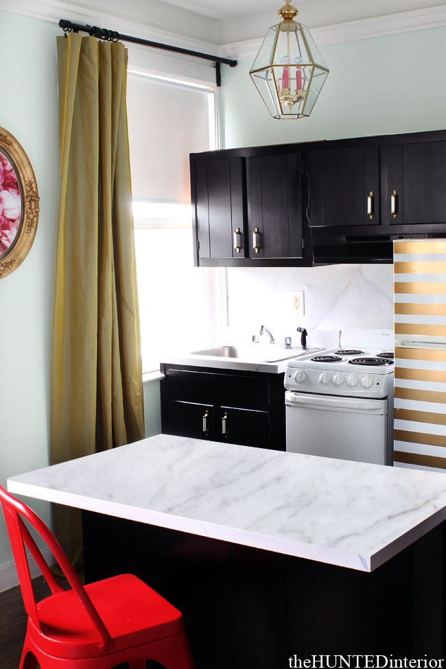 Black Kitchen with a Striped Fridge