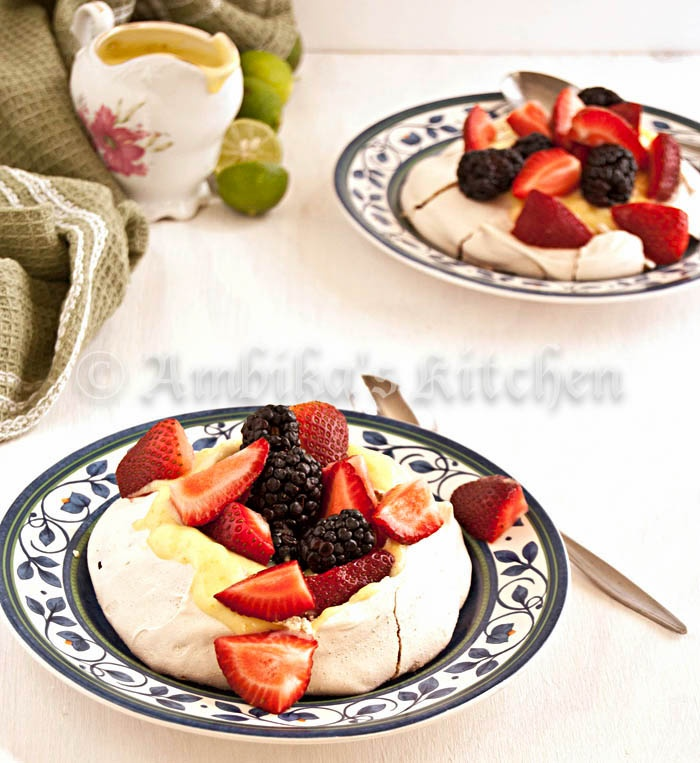 Pavlova with key lime curd and summer berries. Light, crispy, airy and ...